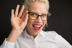 Creative person holding glasses Stock Image
