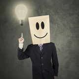 Creative person pointing lightbulb Royalty Free Stock Image