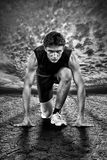 Creative photo of athletes at the start. Royalty Free Stock Photo