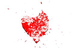 Creative photo of a red human heart symbol, broken into small pieces of glass isolated on a white background. Allegory of unhappy love is a broken heart royalty free stock images