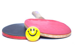 Two rackets table tennis with yellow fun emoticon ball Stock Images