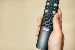 Creative picture. lies on television. Lies on the news. A hand is holding a TV remote with a royalty free stock photos