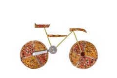 Creative picture of road bicycle made of international pizza and vegetables on white background. Delivery. Royalty Free Stock Photography