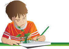 Creative boy drawing his emagination. Royalty Free Stock Photography