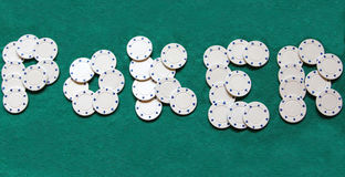 Creative poker sign. Letters forming poker sign with white poker chips royalty free stock images