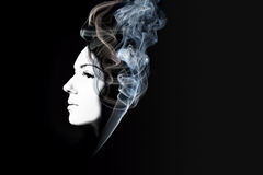 Creative portrait of beautiful girl with smoke Stock Photo