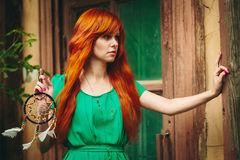 Creative Portrait of Redhead Woman in Green Dress Stock Photography