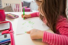 Creative Preschool Child Drawing. Creative Preschool Child, little girl drawing on paper,sitting at table at home stock photography
