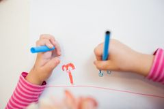 Creative Preschool Child Drawing. Creative Preschool Child, little girl drawing on paper,sitting at table at home royalty free stock photography