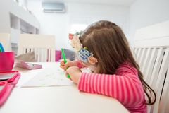 Creative Preschool Child Drawing. Creative Preschool Child, little girl drawing on paper,sitting at table at home stock photos