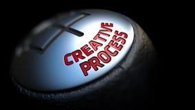 Creative Process on Car's Shift Knob. Creative Process - Red Text on Car's Shift Knob on Black Background. Close Up View. Selective Focus stock image