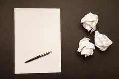 Creative process. Empty sheet of paper with pen next to crumpled up papers as a concept for creativity, ideas or writing Stock Photo