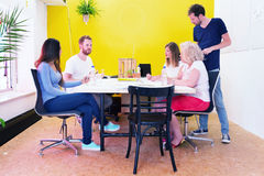 Creative professionals in a design studio stock photo