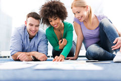 Creative professionals working on floor. Group of creative professionals working on floor royalty free stock images