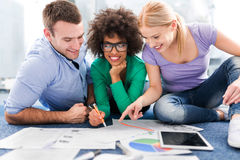 Creative professionals working on floor. Group of creative professionals working on floor royalty free stock photos