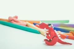 Creative red dinosaur clay model. Play dough animal. Vintage ton Royalty Free Stock Photo