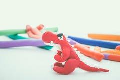 Creative red dinosaur clay model. Play dough animal. Vintage ton Royalty Free Stock Photography