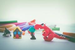 Creative red dinosaur clay model. Play dough animal. Vintage ton Stock Photography