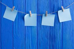 Creative reminder, small sheets of paper on old clothespin. Sale stock photography