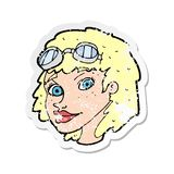 A creative retro distressed sticker of a cartoon happy woman wearing aviator goggles. An original creative retro distressed sticker of a cartoon happy woman royalty free illustration