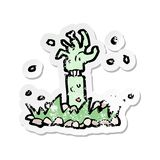 Retro distressed sticker of a cartoon zombie arm. A creative retro distressed sticker of a cartoon zombie arm stock illustration