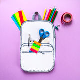 Creative school bag made of paper with school stationery. Close up. royalty free stock image
