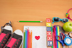Creative school objects on wooden table. Creative school objects on a wooden table Royalty Free Stock Photos