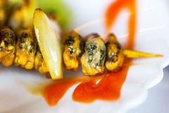 Creative serving fried mussels with herbs, selective focus Royalty Free Stock Photography