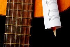 Acoustic guitar, blank music notes, pencil. Creative set of acoustic guitar, blank music notes and pencil Stock Photos