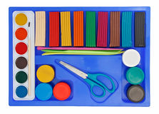 Creative set of aquarelle paint box, plasticine. And scissors isolated on white royalty free stock photo