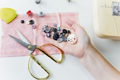 Creative sewing supplies and accessories on a table. Thread, needle, scissors, machine stock photos