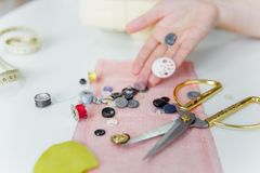 Creative sewing supplies and accessories on a table. Thread, needle, scissors, machine stock photo