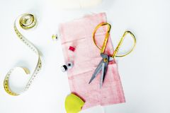 Creative sewing supplies and accessories on a table. Thread, needle, scissors, machine royalty free stock image