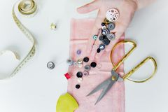 Creative sewing supplies and accessories on a table. Thread, needle, scissors, machine stock photography