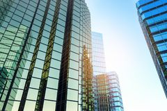 Creative shiny glass skyscrapers. On bright sky background. Urban and corporate concept. 3D Rendering vector illustration