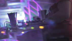 Creative shot of dj performing in nightclub, mixing music sounds on turntable. Stock footage stock footage
