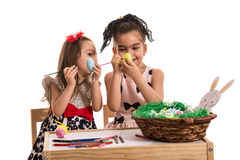 Creative sisters painting Easter eggs Stock Photography