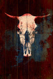 Creative skull of a bull on a wooden background. Skull with bloody horns Royalty Free Stock Images
