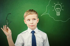 Creative and smart schoolboy has an idea at blackboard Stock Photography