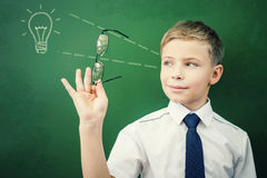 Creative and smart schoolboy has an idea at blackboard Royalty Free Stock Photography