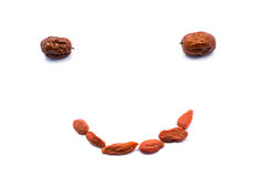 Creative smile face. This smile is the jujube and medlar stitching on white background Royalty Free Stock Photo