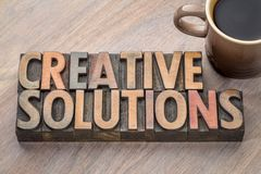 Creative solutions word abstract in wood type Royalty Free Stock Photos
