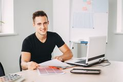 Creative specialist working with color palettes. Young creative specialist working with color palettes. Designer at workplace. Design studio, creative projects stock image
