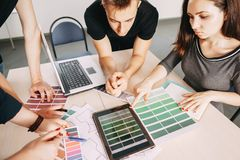 Creative specialists working together with color samples stock image