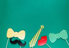 Creative st Patricks Day green background. Flat lay composition of Irish holiday celebration with photo booth decor: royalty free stock photo