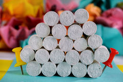 Creative stack of white chalks between two pins. Stock Photography