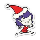 Hand drawn sticker cartoon of a undead vampire girl wearing santa hat. A creative sticker cartoon of a undead vampire girl wearing santa hat royalty free illustration