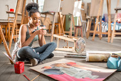 Creative student painting at the university Royalty Free Stock Image
