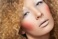 Creative style. Model with curly hair, fun make-up Stock Images
