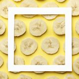Creative summer pattern made of bananas slice on pastel yellow background. royalty free stock image